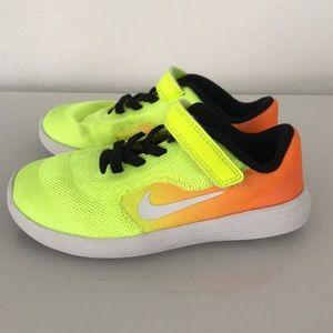 Kids neon Nike Revolution sneakers